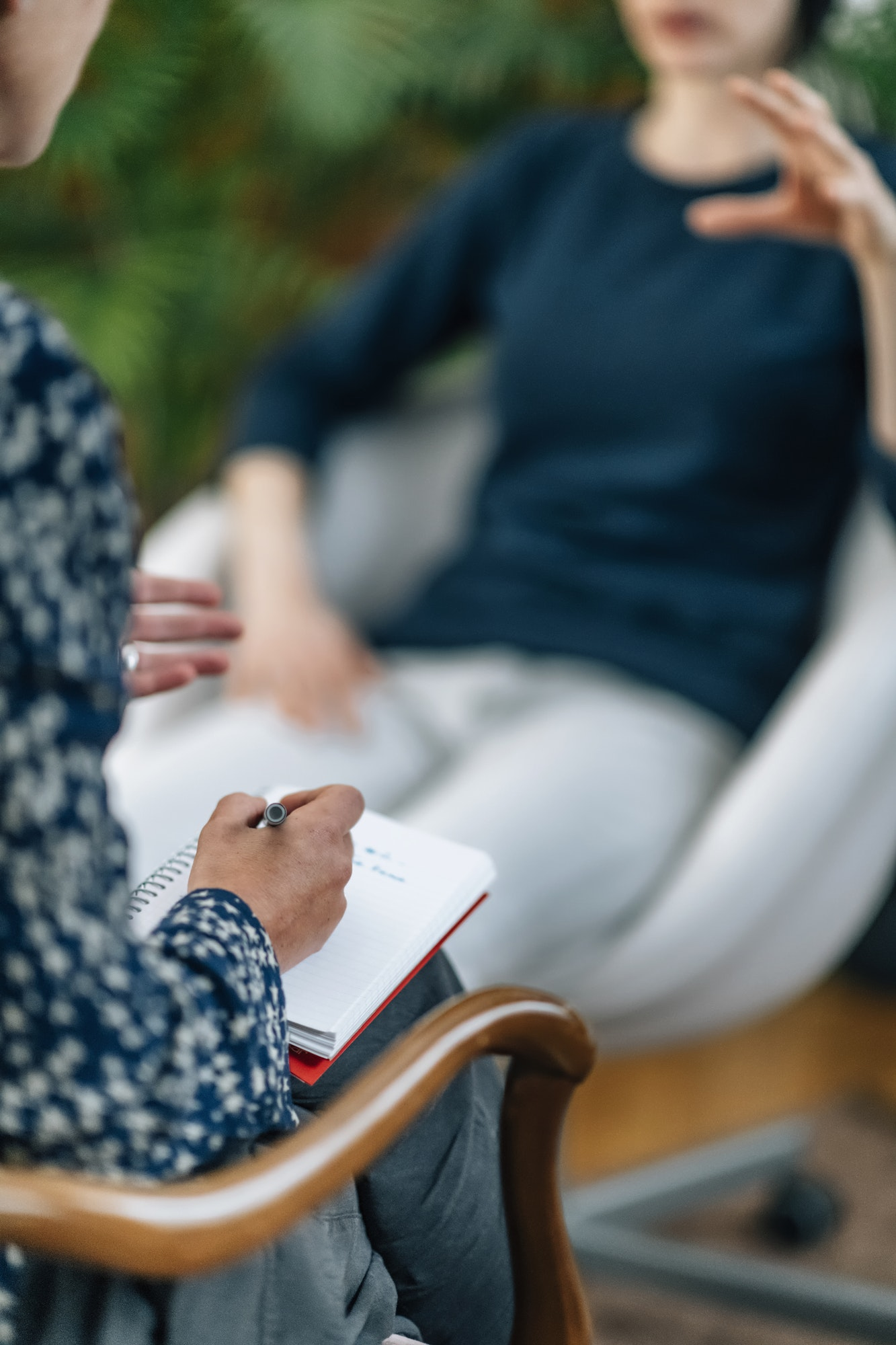 NLP or Neuro-Linguistic Programming Practitioner Having a Conversation with a Client